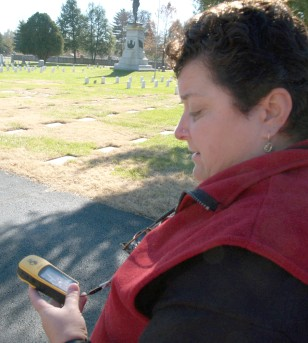 Woman looks at GPS locator