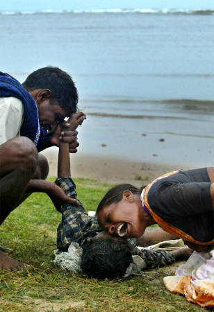 IMAGE: GRIEVING PARENTS IN INDIA
