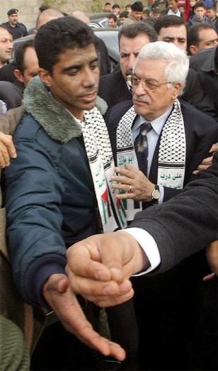 Palestinian presidential candidate Abbas meets commander of al Aqsa Martyrs Brigades Zubeidi