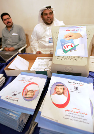 Supporters of Khaled al-Sebaiay, a candidate for Saudi municipal council elections mind the information desk in Riyadh