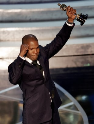 Actor Jamie Foxx celebrates winning the Oscar for best actor at the 77th Academy Awards