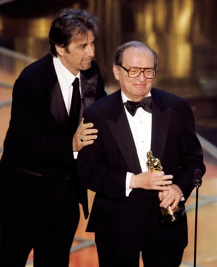 Director Sidney Lumet accepts Oscar from presenter Al Pacino at the 77th Academy Awards