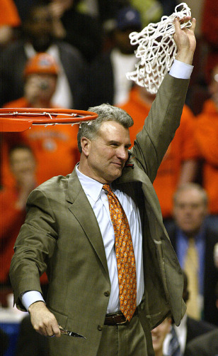 Illinois coach Weber waves to the crowd after winning the Big Ten Championship