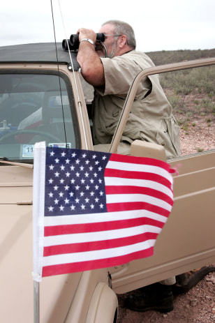 Image: A volunteer stands watch along the U.S./Mexican border.
