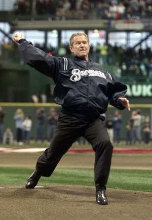 PRESIDENT GEORGE W BUSH THROWS OUT THE FIRST PITCH IN MILLER PARK