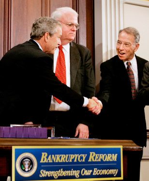 US President George W Bush shakes hands with cosponsors of Bankruptcy Act