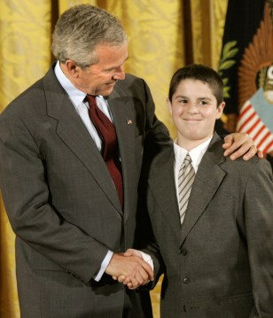 BUSH CONGRATULATES YOUNGSTER