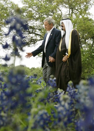 President Bush walks with Saudi Arabia's Crown Prince Abdullah on his ranch in Crawford, Texas, on Monday.