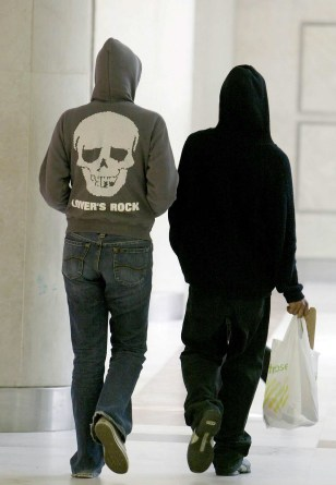 Image: Two youths seen wearing hooded tops.