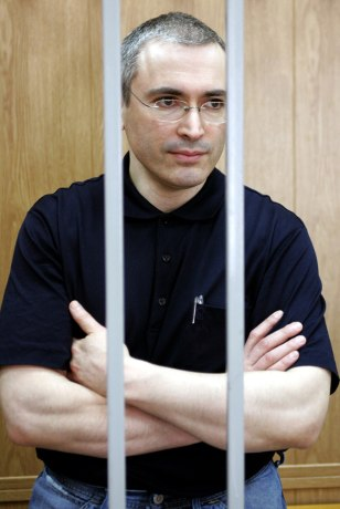 File photo of oil tycoon Khodorkovsky stands in the cage inside a Moscow court