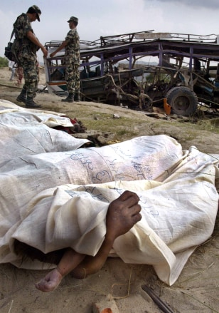 Hands of woman and child is seen as bodies of victims of landmine explosion are covered in Chitwan district, south of Kathmandu