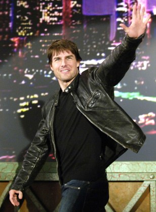 "Actor Tom Cruise waves to the audience upon being introduced by host Jay Leno during a taping of ""The Tonight Show with Jay Leno"" in Burbank, California."