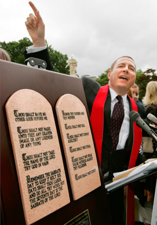 Image: Reverend with display of Ten Commandments.