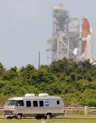 Shuttle crew driven away