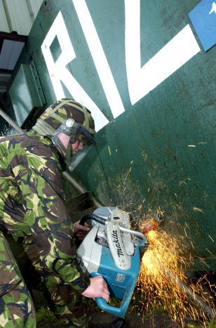 Image: British soldier removes items from Northern Ireland watchtower.
