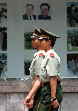 Image: Chinese paramilitary officers in front of North Korean embassy.