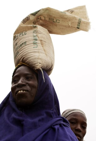 Image: woman carrying food