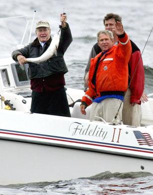 US President George W. Bush (R front) wa