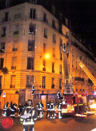 Image: Rescue services at Paris apartment fire.