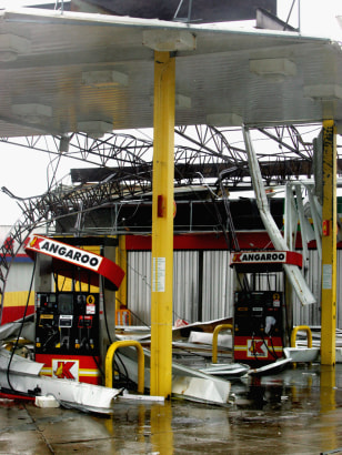 The Kangaroo gas station in Gulfport, Mississippi, is ripped apart by Hurricane Katrina