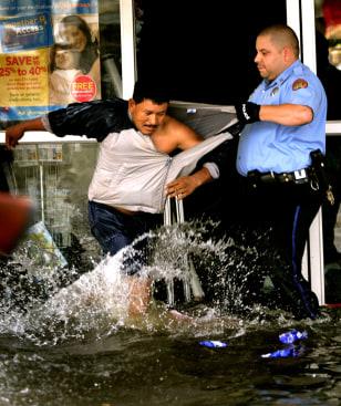 Hurricane Katrina - Police Aprehend Looters - New Orleans