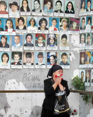 A relative grieves at Beslan school No1 during commemoration of the victims of the school siege