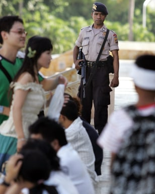 Image: Indonesian policeman guards mall.