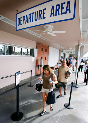 Tourists leave airport of Key West while hurricane Wilma heads towards Floridas southern west coast