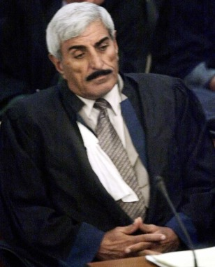 Image: Iraqi defense lawyer Saadoun Sughaiyer al-Janabi on Wednesday at the opening session of the trial of Saddam Hussein in Baghdad's heavily fortified Green Zone. Al-Janabi, who represented one of Saddam's seven co-defendants, was kidnapped by 10 masked gunmen and then found shot dead, police said Friday.