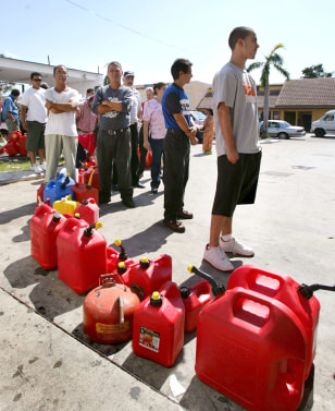 Miami residents wait in long lines for gas in the aftermath of  Hurricane Wilma.