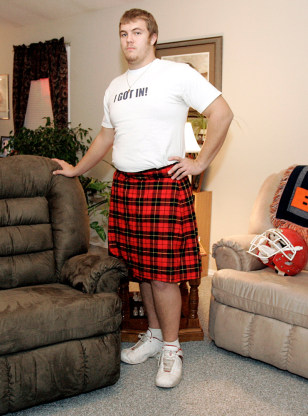 Image: Nathan Warmack shows off his Scottish kilt in the living room of his home in Jackson, Mo.