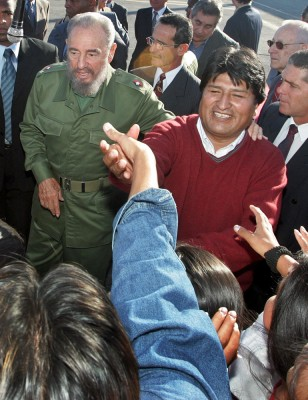 Bolivian President-elect Morales greets Bolivian students as Cuban President Castro watches in Havana