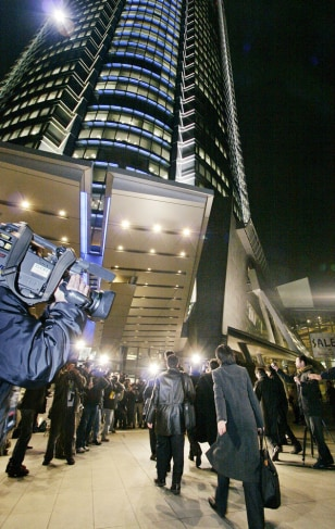 Prosecutors enter the Roppongi Hills bui