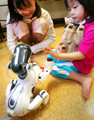 Aibo dog with children