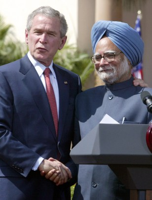 US President George W. Bush (L) shakes hands with Indian PM Manmohan Singh