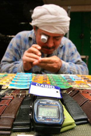 An Iraqi changes the battery of a watch in Baghdad