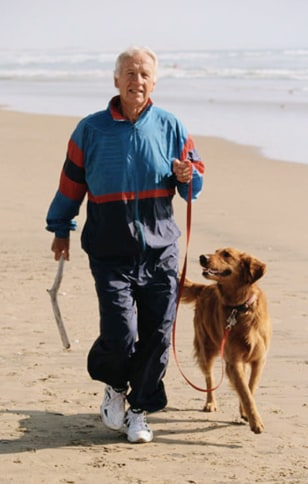 Image: Man walking dog
