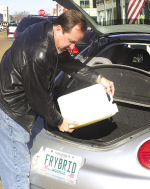 IMAGE: ROBERT TOMEY ADDS BIODIESEL TO HIS CAR