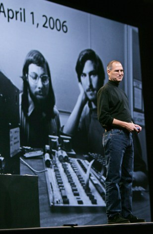 Jobs in front of 30-year-old photo of himself and Wozniak