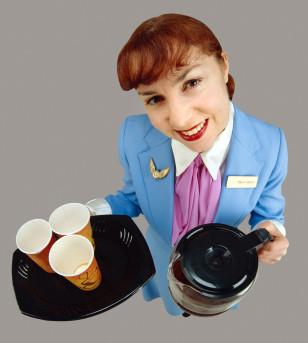 Flight Attendant Offering Coffee