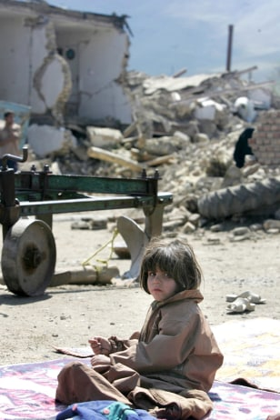 Image: Iranian girl amid quake destruction.