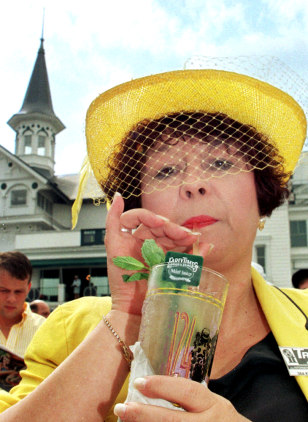 Katie Bradford of Kentucky enjoys a mint julep