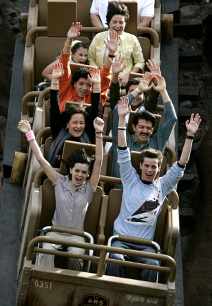 Image: People on roller coaster.