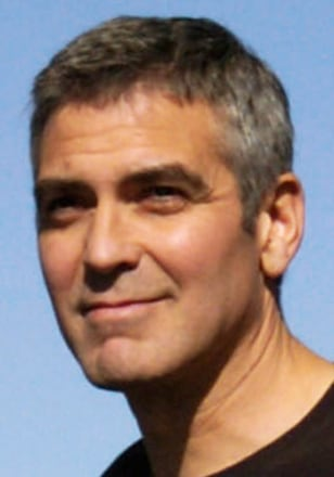 US actor George Clooney (C) escorts his