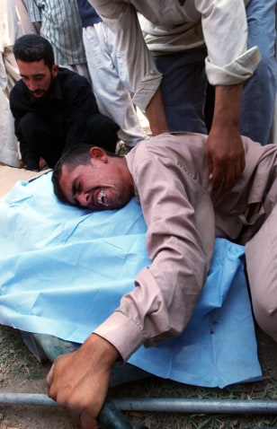 Image: Iraqi man mourns.