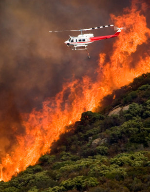 Image: Helicopter flies past flames near San Diego
