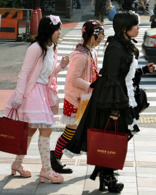 Image: Japanese girls carry shopping bags