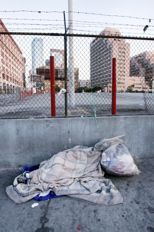 Image: Homeless person sleeps.