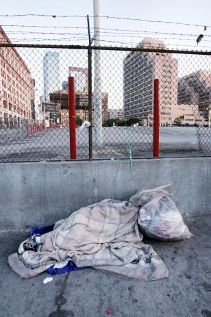 Image: Homeless person sleeps.