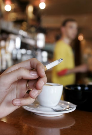 Image: Cigarette in a Paris cafe.